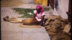 2793 - barefoot workers clean & bag grain in Panama City-vintage film home movie Stock Footage