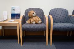 Toy lion in hospital waiting room Kuvituskuvat