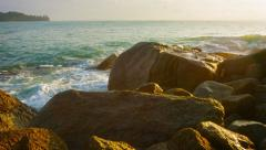 Tropical Waves Splash over Rocks in the Late Afternoon Stock Footage