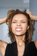 Stock Photo of Businesswoman tearing her hair out