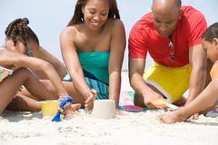 Family making sandcastles Stock Photos