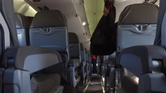 View of airplane seats on a small jet - commercial airliner Stock Footage