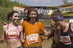 SIGNA, ITALY - MAY 9 2015: Women smiling after the mud run competition near F Stock Photos