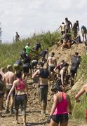 Solidarity through the participant at Mud run - stock photo