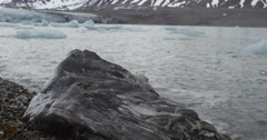 Dolly - Granite Rock in Surf of Arctic Bay Stock Footage
