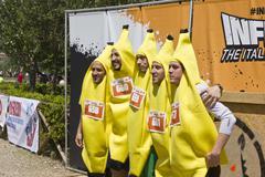 Participant at Inferno Run 2015, dressed a bananas - stock photo
