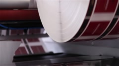 Roll with paper being printed in a printing press Stock Footage