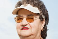 Woman wearing a sun visor Stock Photos