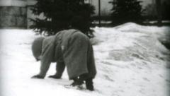 Little Boys Slipping On Ice In Winter-1955 Vintage 8mm film - stock footage