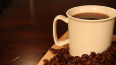 Hot Coffee with Whole Coffee Beans Tracking Shot Stock Footage