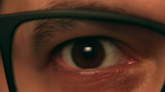Eye Closeup with Glasses Tracking Shot - Right to Left - stock footage