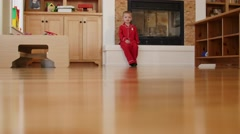 Stock Video Footage of A little boy walks around his house in pajamas and slippers