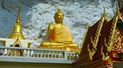Gold Statue of the Buddha at Wat Tham Kisap Temple Stock Footage