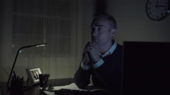 Sad man at his office desk Stock Footage