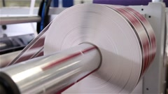 Roll with paper being printed in a printing press, slider shot Stock Footage