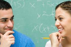 Two students flirting Stock Photos