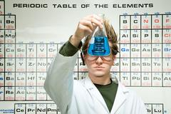 Male student performing an experiment Stock Photos