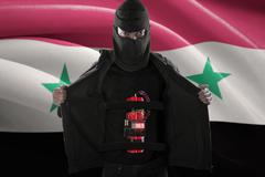 Bomber suicide with flag of Syria - stock photo
