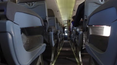 Jib shot of interior of airplane cabin - stock footage