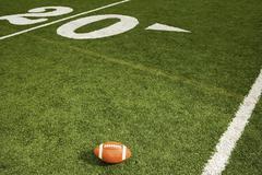 American football on the field Stock Photos