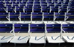 Empty spectator seats - stock photo
