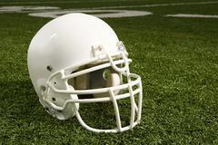 Helmet on american football field Stock Photos