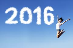 Excited woman jumping on the air with numbers 2016 Stock Photos