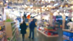People in the store fixtures and chandeliers, defocused Stock Footage