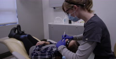 Kids at the Dentist - Getting dental work done by hygienist Stock Footage