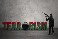 Jihadist with bloody terrorism text - stock photo