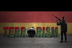 Terrorist with flag of German and terrorism text - stock photo