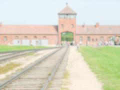 Defocused background of the Nazi Concentration Camp in Auschwitz-Birkenau, Po Stock Photos