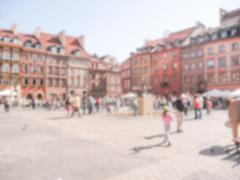 Defocused background of Warsaw's Old Town Market Place (Rynek Starego Miasta) - stock photo