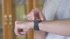 4k Smartwach Being Used On Wrist by Young Adult Making Gestures Stock Footage