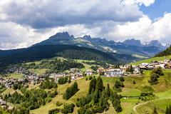 View over the meadows and agriculture in the dolomite alpes, near village Vig Stock Photos