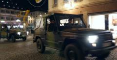 Police officers in military vehicle French City Stock Footage