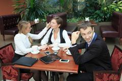 Lesbian girls at the business lunch. man confused. flirt Stock Photos