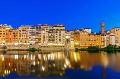 Florence. Ancient houses on the waterfront Stock Photos