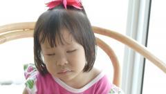 Little girl falls a sleep on chair Stock Footage