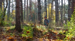Happy Child Running In Autumnal Forest Stock Footage
