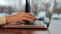 Female hands working on laptop in cafe. slide left Stock Footage