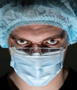 Surgeon in surgical mask - stock photo