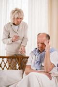 Man with migraine taking painkiller Stock Photos