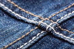 Seams on blue jeans Stock Photos