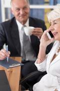 Stock Photo of Senior business people having meeting