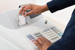 Close-up Of A Sales Person Operating Cash Register Kuvituskuvat
