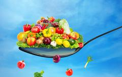 Spoon full of various fruit and vegetables - stock illustration