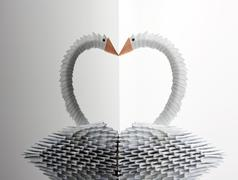 White origami swan with reflection Stock Photos