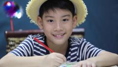 little asian happy boy painting, with smile face - stock footage