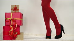 Woman in high heels with christmas gifts 4K. Stock Footage